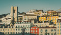 Cityscape hill with church and multiple colorful houses Royalty Free Stock Photo