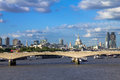 Cityscape of London in late afternoon light from Hungerford Bridge. Royalty Free Stock Photo