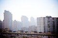 Cityscape in morning haze sunny weather Royalty Free Stock Image