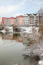 Cityscape moscow first frost snow bound shore and covered by thin ice pond Stock Photography