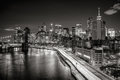 Cityscape at night of Lower Manhattan Financial District with illuminated skyscrapers. New York City Black & White Royalty Free Stock Photo