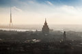 Cityscape panorama of riga latvia december town with tall living house and tv tower in the fog on the coast daugava river Stock Photography