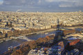 Cityscape of paris shadow from the eiffel tower visible on the picture warm sunny rays just before early sunset in winter view to Stock Photo