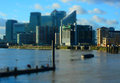 Cityscape from river tilt shift miniature effect of view thames with london s canary wharf in the blurred background Royalty Free Stock Photo