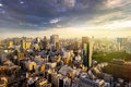 Cityscape of Tokyo, city aerial skyscraper view of office building and downtown and street of minato in tokyo with sunset / sun Royalty Free Stock Photo