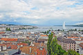 Cityscape view and shoreline of lake geneva switzerland august from atop a cathedral tower august Royalty Free Stock Photography