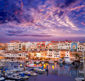 Ciutadella menorca marina port sunset with boats and streetlights in balearic islands Stock Image