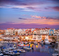 Ciutadella menorca marina port sunset with boats and streetlights in balearic islands Royalty Free Stock Images