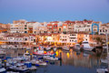 Ciutadella menorca marina port sunset with boats and streetlights in balearic islands Royalty Free Stock Photos