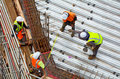 Civil engineer supervise roof construction workers work Royalty Free Stock Photo