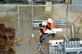 Civil engineers inspecting construction site Royalty Free Stock Photo