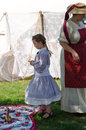 Civil war re enactors and retro toys a woman child in clothing play with antique at the jackson muster in michigan usa Stock Images