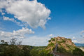 Civita hill town hilltop in italy shown with surrounding area under a large sky Stock Photo