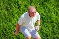 Older man plays pétanque. Royalty Free Stock Photo