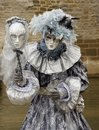 Clad woman in venice with a mask a costume from Royalty Free Stock Images
