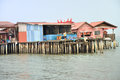 Clan jetties of penang the are unique chinese settlements that have been around since the th century along the wooden pier are Royalty Free Stock Photography