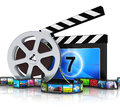 Clapper board film reel and filmstrip cinema movie video media industry production concept metal with colorful pictures Stock Image