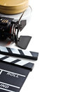 Clapper board with movie light and film reel on white background Royalty Free Stock Image