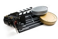 Clapper board with movie light and film reels on white background Stock Image