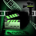 Clapper board and projector abstract colorful background with clapboard movie numbered filmstrips cinema theme Royalty Free Stock Image