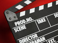 Clapper board on red background Stock Photography