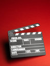 Clapper board on red background Royalty Free Stock Photos