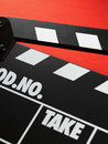 Clapper board on red background Royalty Free Stock Images