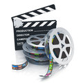 Clapper board and reels with filmstrips Stock Photography