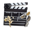 Clapperboard with d glasses top view of and popcorn on white background Stock Photos