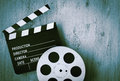 Clapperboards and the reel of film Royalty Free Stock Photo