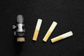 Clarinet mouthpiece and reed the on black background Stock Photos