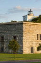 Clark's Point Lighthouse Sits on Fort Taber on a Warm Summer Evening Royalty Free Stock Photo
