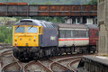 Class 57 diesel locomotive leaving Carnforth. Royalty Free Stock Photo