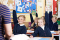 Class Of Elementary School Pupils Answering Question Royalty Free Stock Photo