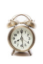 Classic alarm clock ringing at eight o clock isolated against a white background brass metal retro style Royalty Free Stock Images