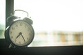 Classic alarm clock on the window Royalty Free Stock Photo