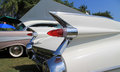 Classic american car tail lamps and fins pointy tailfins on cadillac Royalty Free Stock Photo