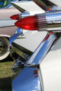Classic american car tail lamps pointy on cadillac focus on lamp and fin in background Royalty Free Stock Photos