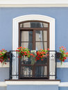 Classic balcony with flowers at summer time Stock Images