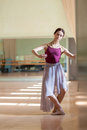 Classic ballet dancer posing at barre on rehearsal Royalty Free Stock Photo