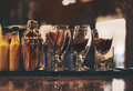 Classic bar counter with bottles in background Royalty Free Stock Photo