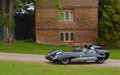 : Classic Black Lotus racing car in front of old building. Royalty Free Stock Photo