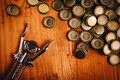 Classic bottle opener and pile of beer bottle caps Royalty Free Stock Photo