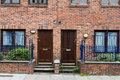 Classic brick walls with doors brown houses and Royalty Free Stock Photos