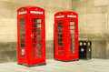 Classic british phone booths traditional red in manchester Stock Photos