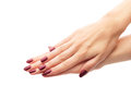 Classic burgundy manicure female hands with perfect over white isolated background Stock Photo