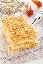Classic cake napoleon silver blade with a of puff pastry on a linen napkin Royalty Free Stock Photo