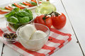 Classic caprese ingredients mozzarella cheese tomatoes basil Stock Photo