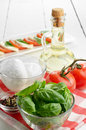 Classic caprese ingredients mozzarella cheese tomatoes and basil Stock Photos