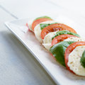 Classic caprese with mozzarella tomatoes and basil Royalty Free Stock Images